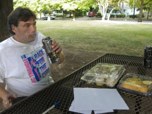 Transient Doug Bacon enjoys a beer in Rogers Park, a popular, shady place for homeless people and their friends to drink on summer afternoons.