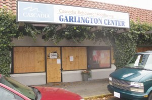 Boarded up windows show where a fire gutted the Garlington Center