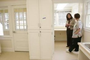 Business manager Jodie Jones (left) on Thursday gives nurse Judy Hanson a tour of one of the remodeled cottages on the grounds of the Oregon State Hospital.