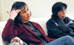 Jackie Feik, left, and her sister Bonda Powell sit in their sister's Redmond home Thursday evening. Their sister, Cindy Powell, committed suicide Monday at St. Charles Bend.
