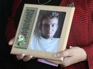 Dorothea Carroll holds a picture of her son, Andrew Hanlon, who was fatally shot by a police officer in Silverton, Oregon in 2008. Hanlon was showing signs of paranoia and possible schizophrenia when he was shot.