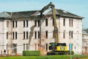 Dismantling of the Oregon State Hospital's historic J building began April 6. A federal report about conditions at the hospital prompted major changes, including plans to build a new facility.