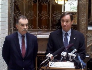 Police Commissioner Dan Saltzman and deputy city attorney Jim Rice hold a press conference