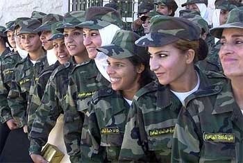 New Iraqi women soldiers pose after their graduation ceremony in Jordan's Military Academy in Zarqa