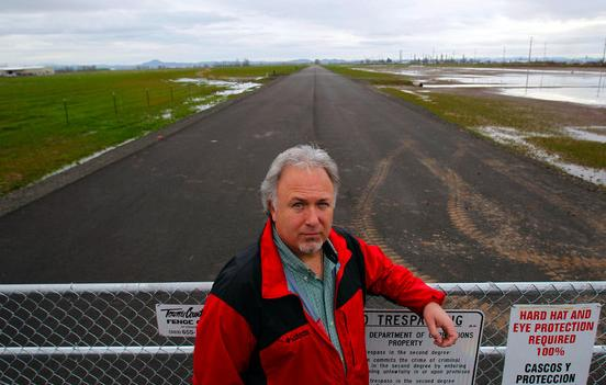 Junction City mayor David Brunscheon stands next to the site of the proposed state prison and mental hospital.