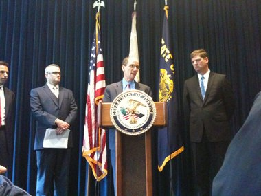 Assistant U.S. Attorney General Thomas E. Perez (center) flanked by Portland Mayor Sam Adams (left) and U.S. Attorney Dwight Holton, announces a federal review of the Portland Police Bureau today.