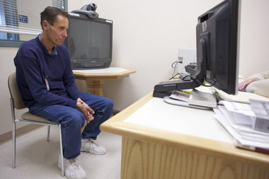 Inmate Ken R. White, 44, speaks with a mental health nurse practitioner at Deer Ridge Correctional Institution. The Corrections Department has expanded its mental health care in recent years but is still short on staff for mental health emergencies at nights and on weekends.