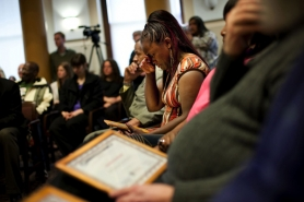 A tearful Darlean Armstead clutches her certificate after graduating from the Portland Police Bureau's Service Coordination Team rehabilitation program for the city's most frequently arrested citizens.
