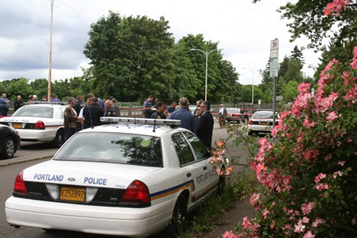 Officials including Mayor Sam Adams and Police Chief Mike Reese discuss the details of the shooting before a police spokesman provides an update to reporters.