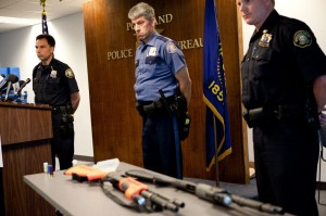 Portland Police Chief Mike Reese, (left) Lt. Robert King and Training Commander Robert Day listen to questions from the media during a Friday press conference to address the accidental shooting of a man by an officer firing a less-lethal shotgun loaded with live ammunition. 