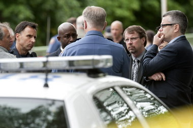Portland police supervisors huddle with Mayor Sam Adams at the scene of Thursday morning's officer-involved shooting.