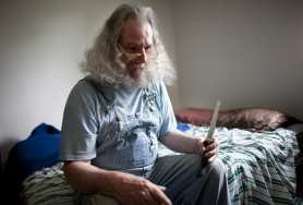Henry Linebaugh, holds a knife he sleeps with because it makes him feel safe. Linebaugh is a former patient of the Oregon State Hospital in Portland and Salem who says peer counseling saved my life.