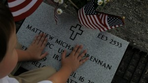 Aiden Brennan, 5, becomes familiar with his brother's newly placed headstone this month at Willamette National Cemetery.