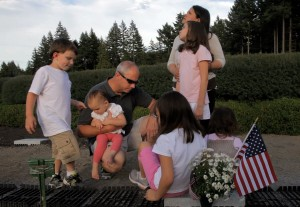 Mike and Maria Brennan visit Matt's grave daily with his younger brother and sisters, from left, Aiden, 5, Isabella, 1, Ariel, 7 (back to camera), Christina, 9 (standing with her mother), and Sophia, 3 (back to camera).