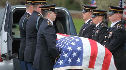 Sgt. Anthony McDowell is laid to rest. (Image: OregonLive.com)