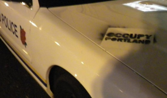 An Occupy Portland sign occupies a Portland Police cruiser. (Image: The Gateway Pundit)