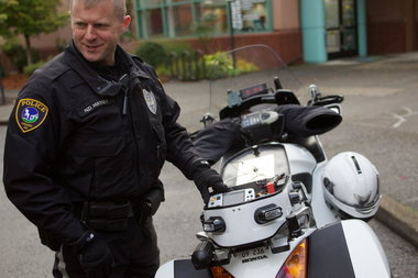 Tigard police Officer Nelson Massey shows the new camera on his motorcycle.  (Image: Bruce Ely/The Oregonian)