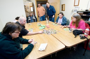 Champion Team members work together to make Christmas ornaments on a recent Saturday.