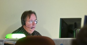 Mark Cameron answers calls in the Multnomah County Mental Health Call Center where 13 mental health professionals staff the phones to help people in crisis.