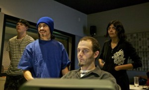 """Mark """"Ivan"""" Kolyvanov (from left), 19; Talilo Marfil, 22; Chip Sloan (at the controls); and Leticia Castaneda, 21, edit film at Digital One in Southwest Portland."""