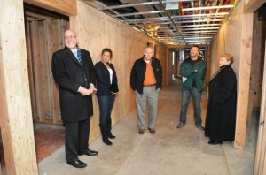 Trillium Family Services officials take a tour of Old School Tuesday morning. From left are Kim Scott, Kristi Cole, Mike Morse, Stan Sawicki and Cheri Galvin.