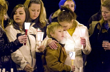 Ashley Grahn holds her brother, Kyle, during a 2010 remembrance for their mother, Charlotte.  (Photo: Brent Wojahn/The Oregonian)