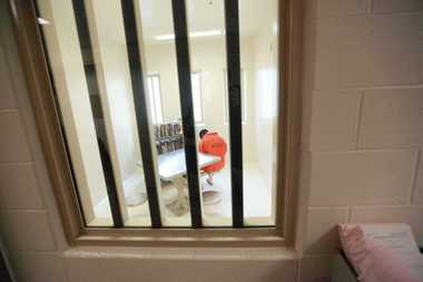 An inmate patient at the Washington State Penitentiary in Walla Walla reads in a room at the Psychiatric Ward last October. Prison counselor Ming Zhu remains on duty at his two full-time jobs, one at the Walla Walla prison, while both Oregon and Washington investigate his conduct holding two full-time jobs.