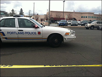 Portland Police investigate a suicide in their North Precinct parking lot Saturday.