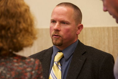 Portland Police Officer Dane Reister talks to his attorney Janet Hoffman, left.