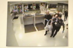 This image shows police carrying James Chasse into the jail. The image was on display during a 2010 press conference.