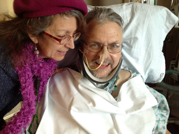 Debra Nuñez with her husband, David Oaks, in his room at Sacred Heart Medical Center at RiverBend where he is in the Neurology Department recuperating from a broken neck and other injuries.
