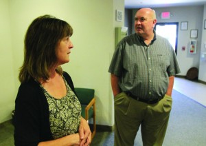 Stan Gilbert, executive director of Klamath Youth Development Center, and Chris Eddy, licensed clinical social worker with Phoenix Place, the county's only respite and residential mental health care facility, provide a tour of the facility.