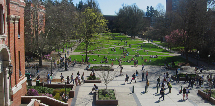 Students hurry to and from classes at the University of Oregon in Eugene.