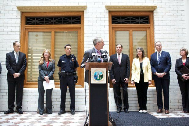 Portland Mayor Charlie Hales, who serves as police commissioner, stood with U.S. Attorney Amanda Marshall and Police Chief Mike Reese, on the left, and city commissioners, on the right, to announce the city had reached a tentative agreement on police reforms with the police union.(Thomas Boyd/The Oregonian)