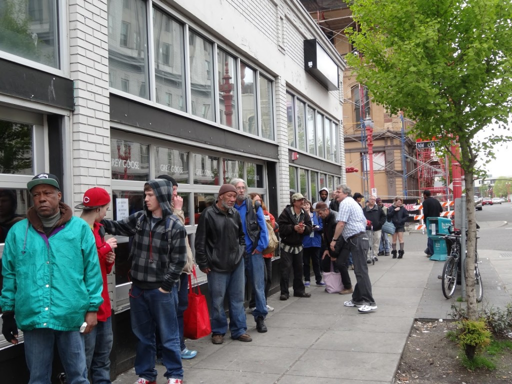 People wait in line outside the Union Gospel Mission.