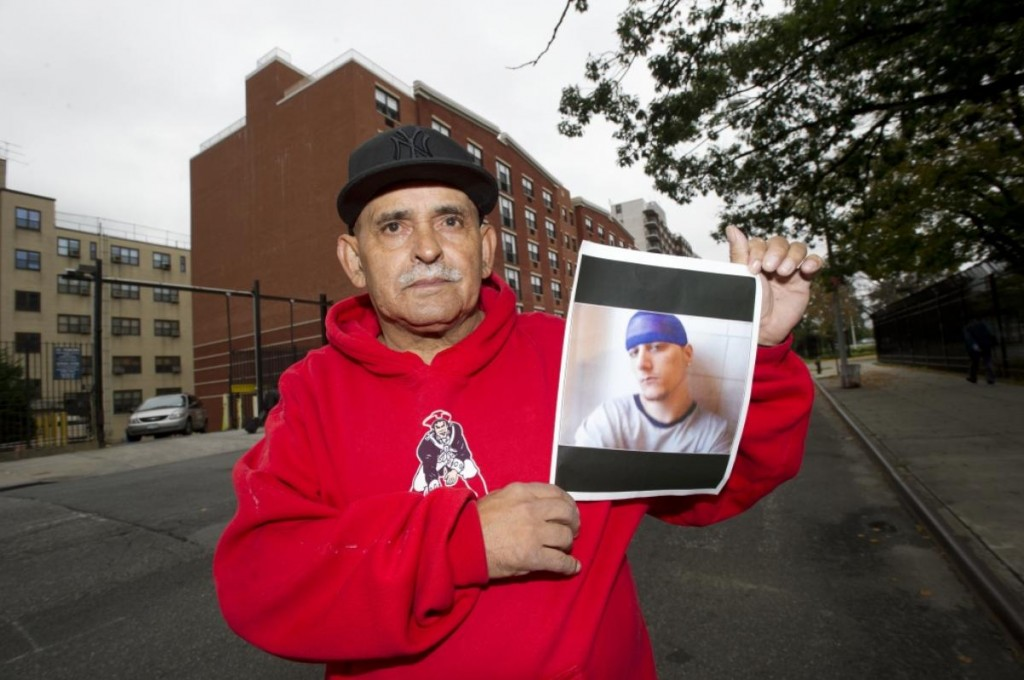 Ramon Echevarria holds a photo of his son Jason Echevarria, who died in 2012.