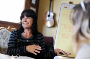 Pamela Rangel leads a group discussion about how to change unwanted behaviors at SHAMA House, a non-profit in North Bend that offers peer support classes for adults with mental illness.