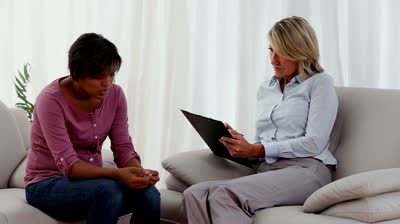 stock-footage-therapist-taking-notes-while-woman-explains-her-problems