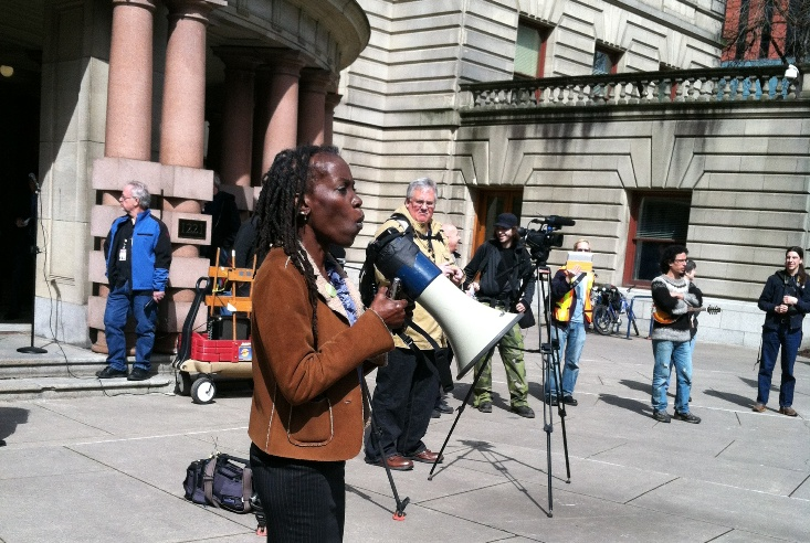 JoAnn Hardesty speaks at a protest .