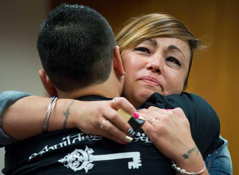 Tiare Mathew embraces longtime girlfriend Gina Orozco.