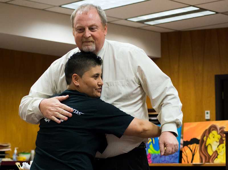 Tiare Mathews hugs her probation officer, David Cadd.