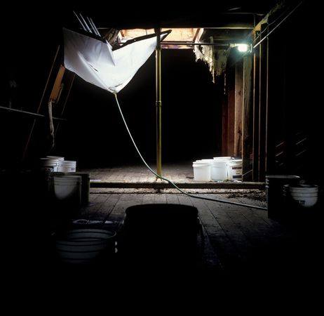 Above patients' heads, attic of J Building falls apart (2004 photo)
