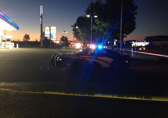 Night scene of police car at site of Amanda Gatewood shooting