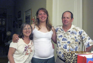 Diana Showman (center) with her mother and father.