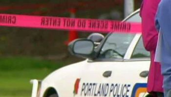 PPB car behind crime scene tape