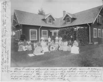 Women patients doing needlework and making baskets in front of a women's cottage on the grounds of Morningside Hospital, 1915