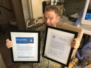 "Scott with ""Thank You!"" plaques from State of Oregon and Multnomah County."