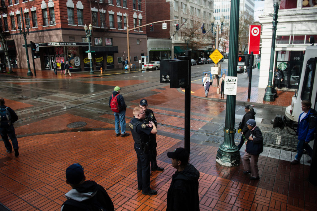 Officers Michael Hastings and Brad Yakots on duty in downtown Portland